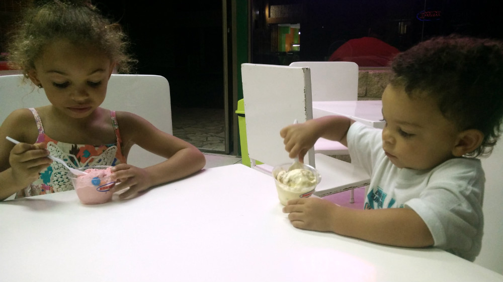 Old enough to each get their own cup of ice cream now.