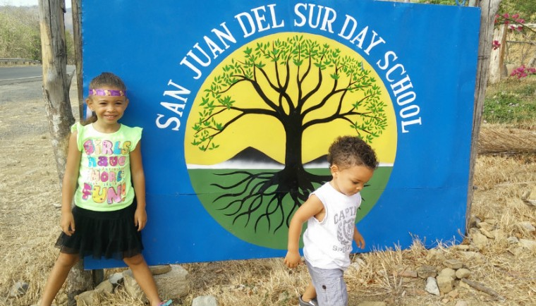 Kids by the school sign