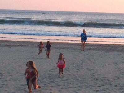 Never get enough of playing on a warm beach at sunset